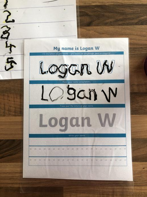 Logan practising his name writing