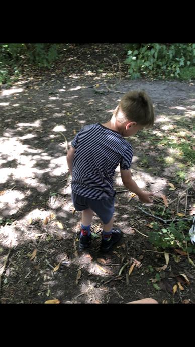 Logan finding garden friends!