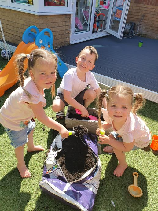 Rosie, Lilly and Ollie doing a spot of gardening