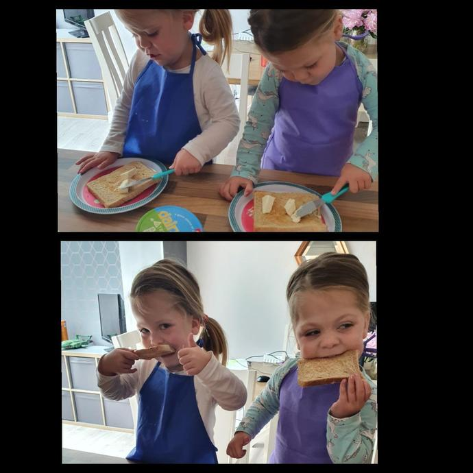 Buttering and eating toast!