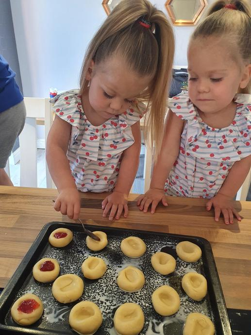 Rosie and Lilly making jam filled biscuits