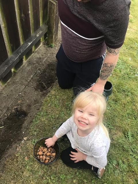 Jami-Leigh planting some bulbs