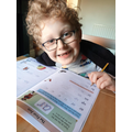 Charlie doing his home learning packs.