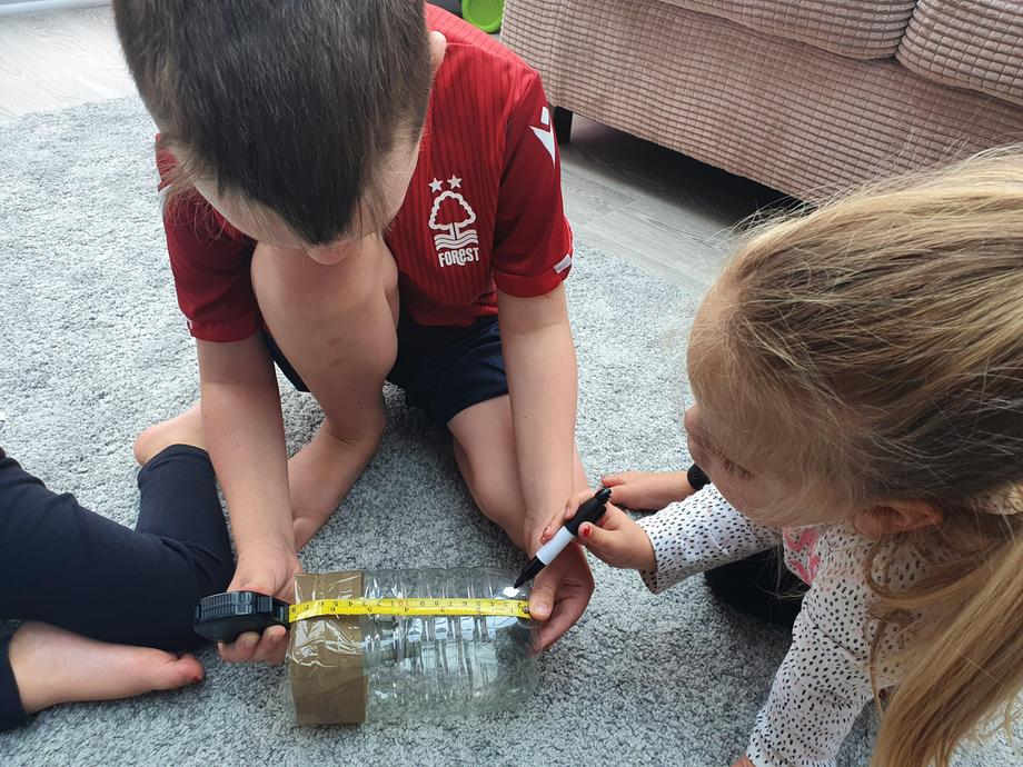 Lilly,Rosie and Ollie making their rain gauge