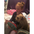 Ellie reading to her dog, Ozzy
