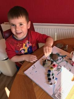 Rory painting stones that he had collected