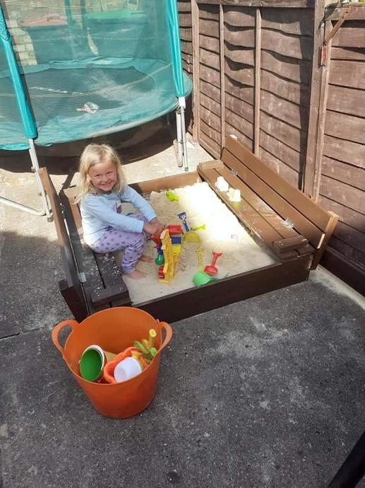 Amelia-Lilly in her new sandpit