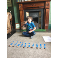 Daniel has been dividing using counters.