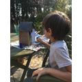 Daniel making a bird house.
