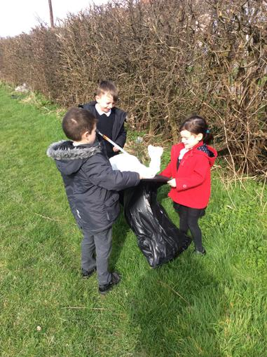 Through their topic, Class 1 have been looking at the local area.  They have taken walks and found things that they liked and areas that they could improve.  One area that they wanted to improve was the amount of rubbish littering the hedgerows.  They decided to go on a big litter pick to improve the local area.  They did a wonderful job and filled 10 bin bags of rubbish.  Well done Class 1.