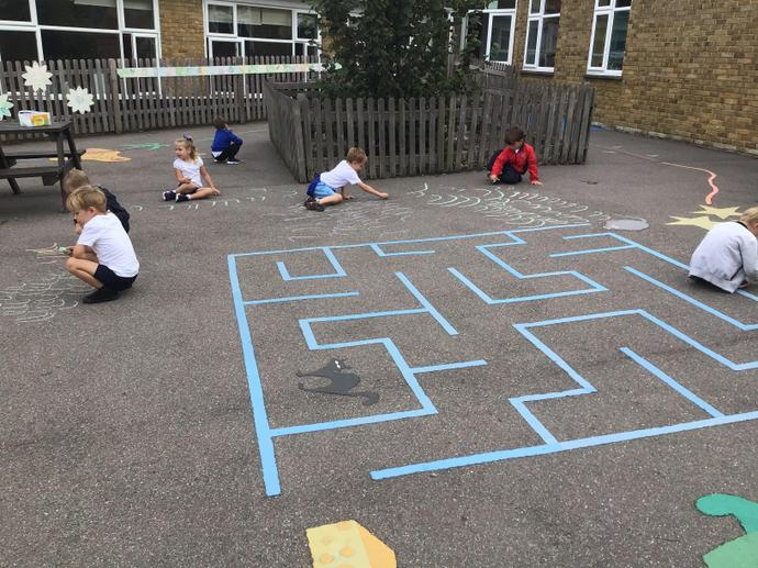 We used chalk to write the letter l.