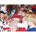 Pupils learning Tudor etiquette