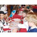 Pupils learning Tudor etiquette