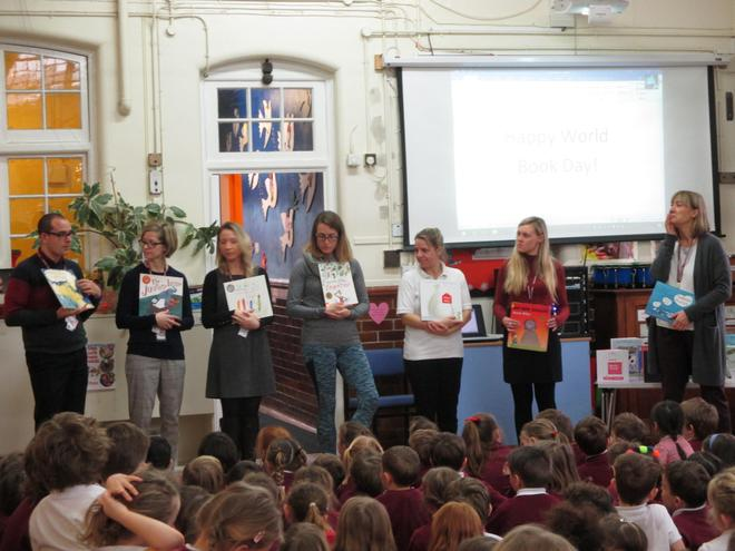 Teachers showing books they shared in Book Week