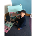 The children enjoyed playing with the doll's house
