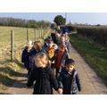 Reception children walking to St. Mary's
