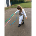 The children enjoyed the stick and hoop game