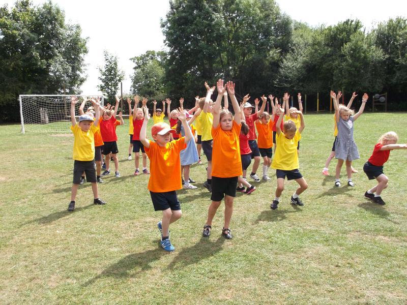 Mayhew class 'fire dance' at Westonbury Festival