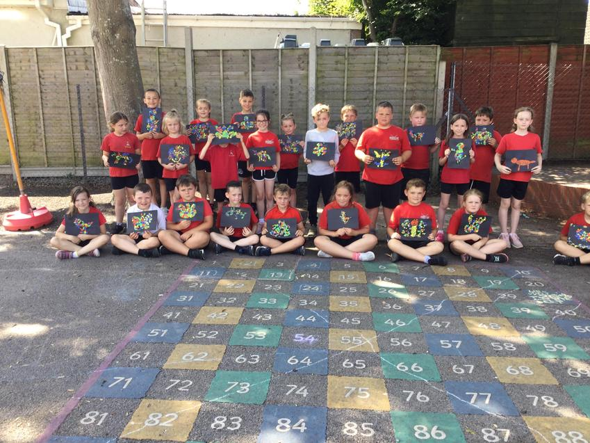 The class are very proud of their mosaic animals made from painted pasta sheets.