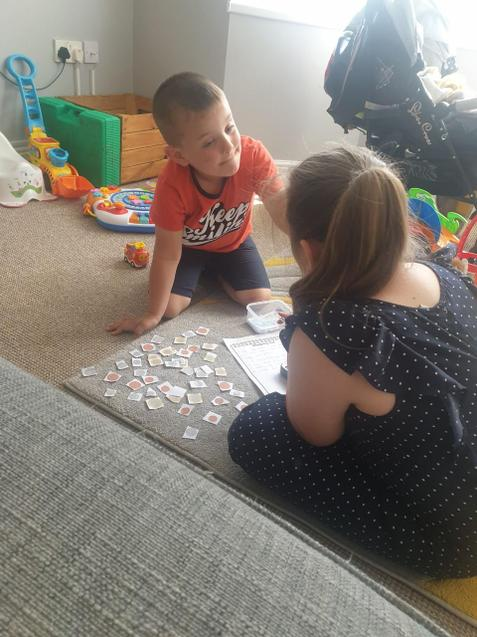 Big sister teaches about money.
