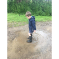 Is he standing on that puddle?