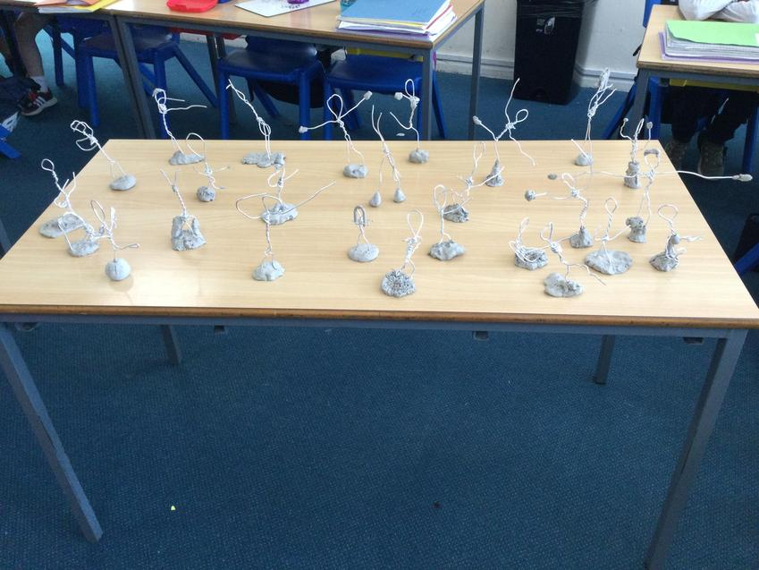 Class collection of their awesome human sculptures made from wire and clay.