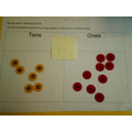 Partitioning numbers into tens and ones.