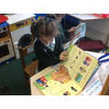 Hollie enjoying a book in the reading corner