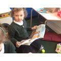 Freya reading in the book corner