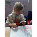 Year 2- In Art we printing and making negative stencils to make a rainforest paintings