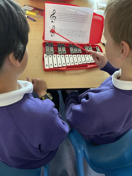 Practicing reading notation on the glockenspiels.