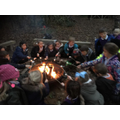 Toasting marshmallows around the camp fire