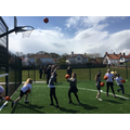 Taking the first shots in the netball hoop