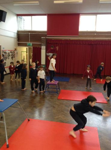 Learning a range of jumps and rolls in PE