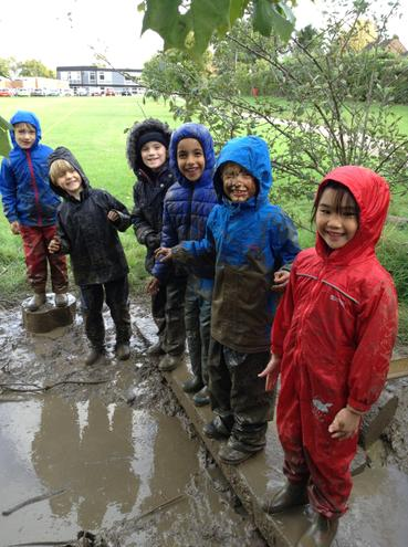 Testing our waterproofs in Forest School!