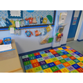 In our maths area, different activities are laid out for the children to explore.