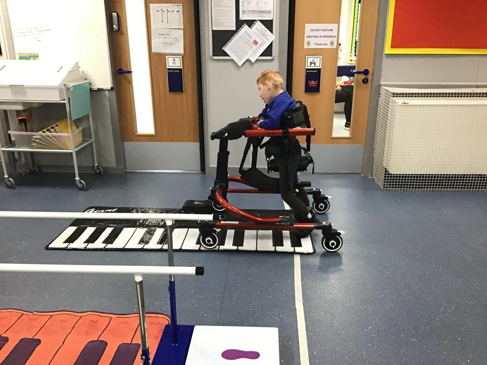 Alfie taking steps in mobility. Go Alfie!