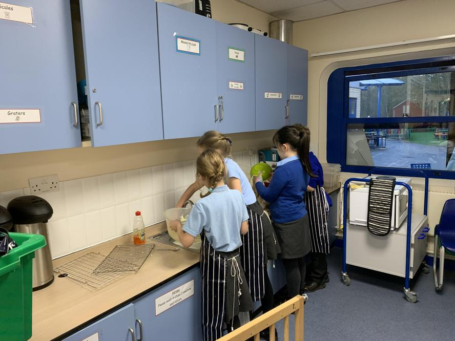 Cooking club get involved in the washing up too.
