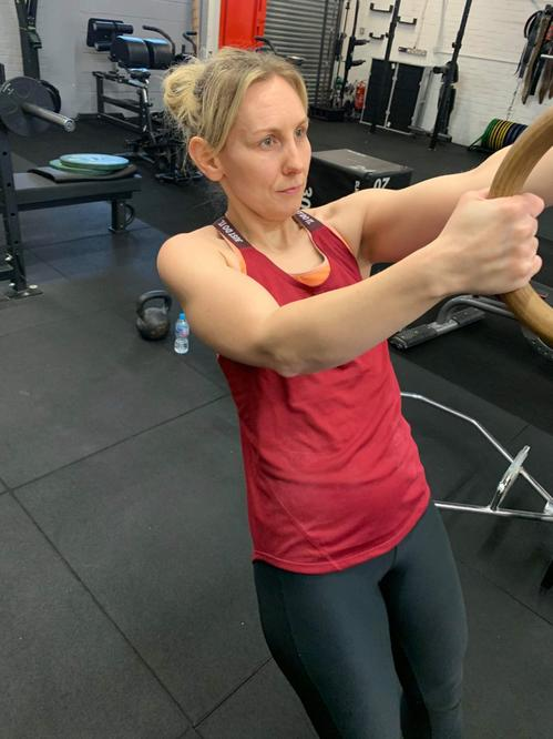 Mrs Stock relaxes in the gym working out.