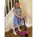 Phoebe is showing us her new scooter.