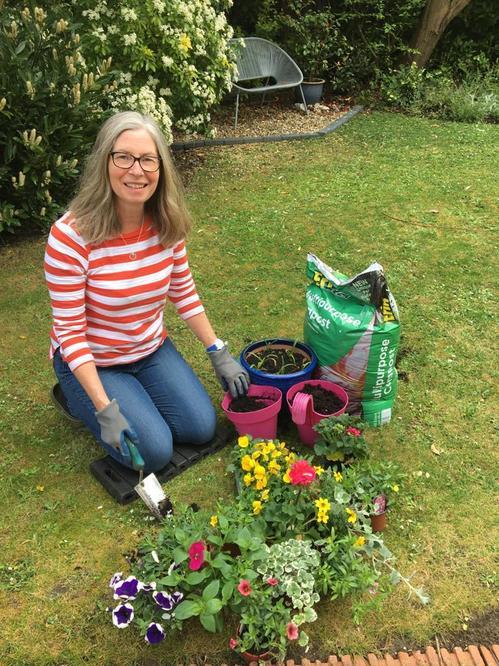 Mrs Truman relaxing in her garden.