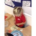 Scissor skills in the playdough
