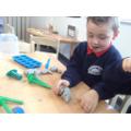 making minibeasts with playdough