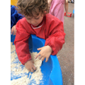 Exploring Moon Sand (baby oil and flour)