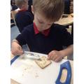 Charlie enjoys spreading snack