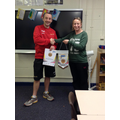 Mr Anderson presenting Mrs Jobling with our award.
