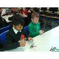 Kian and Raheel making Christmas trees