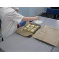 brushing the scones before baking