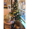 Decorating our tree.