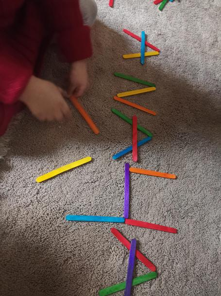 Anaya has been making 'A' for Anaya using lolly sticks 🌟